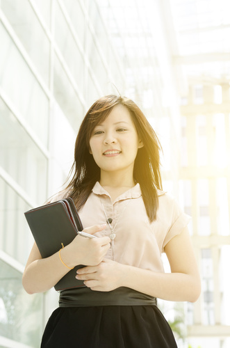 Young Asian female executive walking
